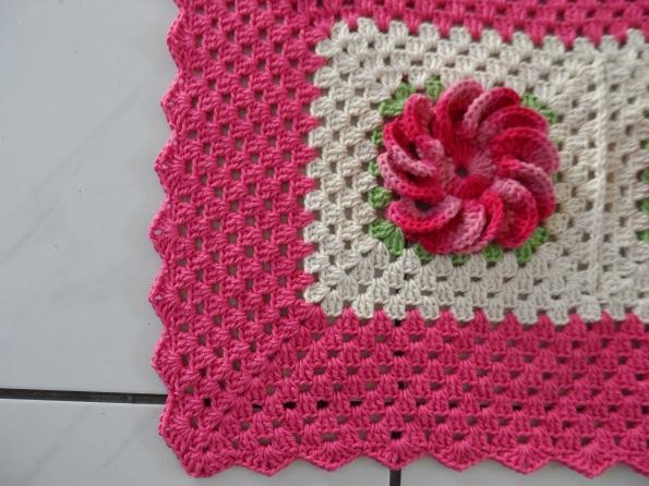 Detalhe do tapete com flor mexerica